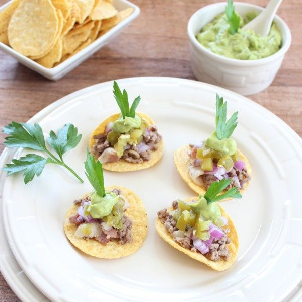 Mini Tacos with Avocado Cream Sauce  I would put it all on top of a nice piece of Romaine instead of the corn chip.