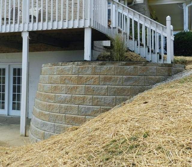 Fixing walk out basements with retaining walls christmas for Walkout basement retaining walls