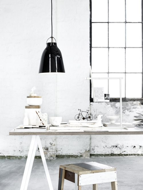 Industrial interior. Plywood table top: white with timber.
