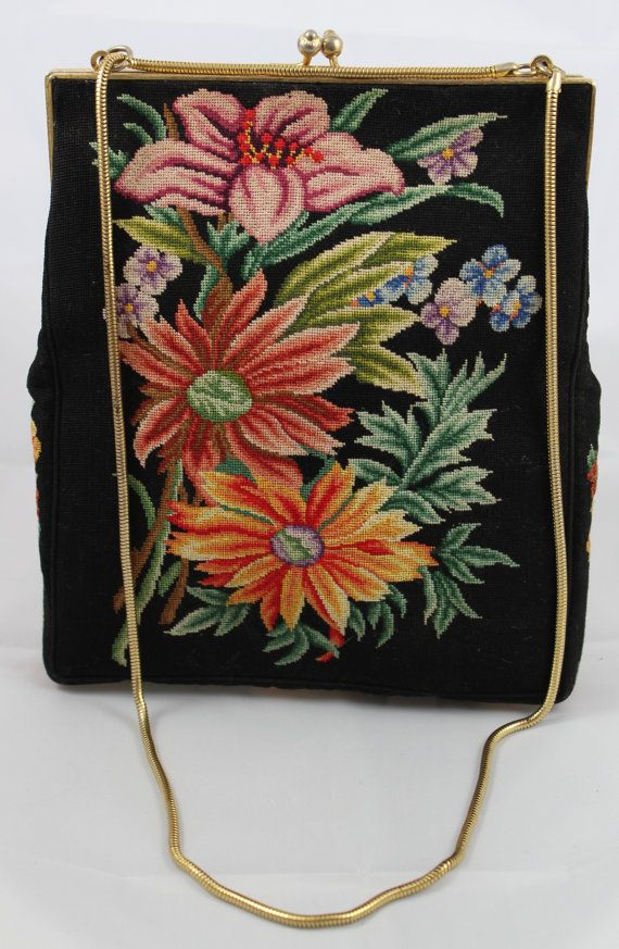 Both sides have vibrant floral needlepoint on this clean, lovely bag. In beautiful vintage condition.  7 X 8 X 1.5