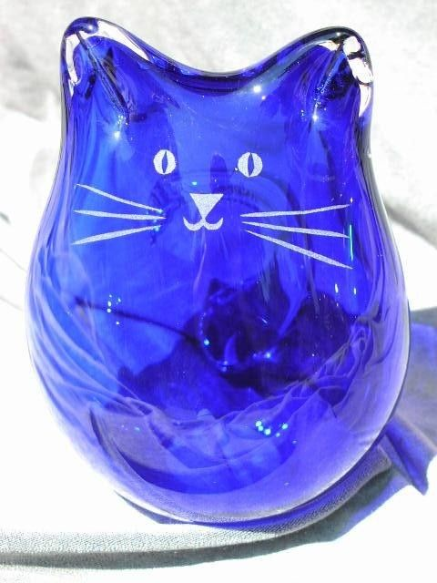 Cobalt blue blown glass cat  http://www.arcreactions.com/areospace-website-design-3/