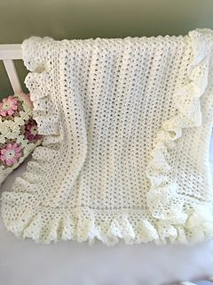 Crochet Baby Blanket Pattern. ♥ This lovely baby blanket has a timeless quality. It is light and lacy and is accented with a huge lightly ruffled border. It would be a welcome and sweet gift for a little newborn.
