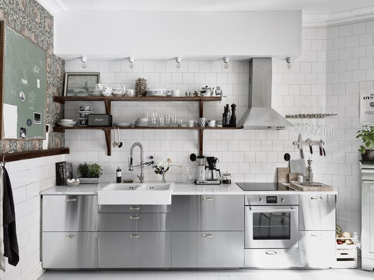 A case of opposites attracting? Ikea stainless steel cabinets meet William Morris wallpaper in designer blogger Tant Johanna's eye-opening Gothenburg, Sweden, kitchen.