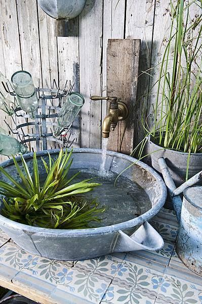 Make a tabletop fountain with an old galvanized pan and faucet