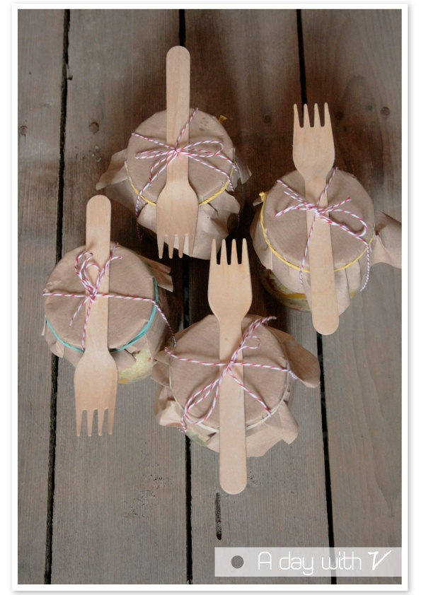 Fill mason jars with cake or treat, cover with brown paper and tie a wooden fork on with string. Great idea for a kids b day party.