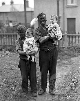 Miner & his family, Rhondda Valley, South Wales, 1931