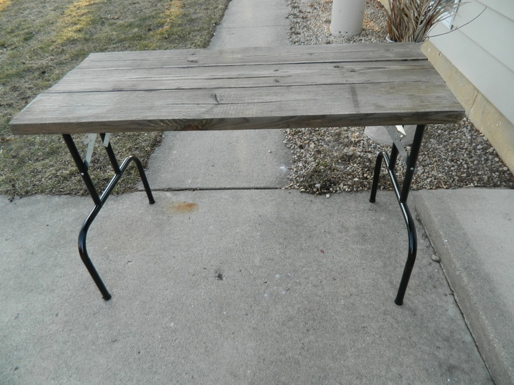 small reclaimed wood table/work desk with folding metal legs, use folding legs removed from an old folding table or order a set from Amazon