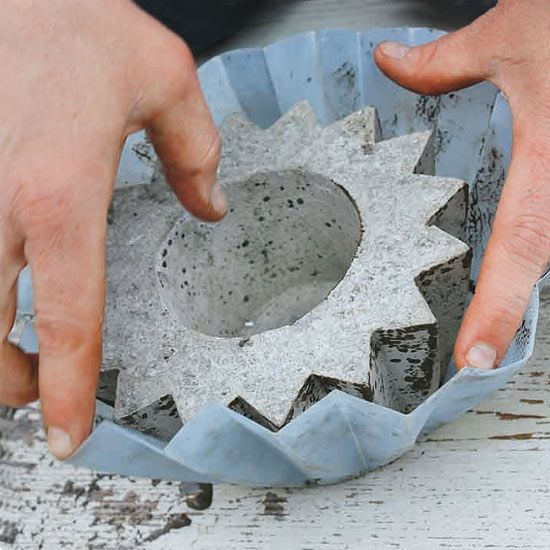 Concrete DIY molds, awesome for decks and apartments, or to weigh anything down in the office! Very cool.