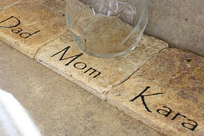 Personalized coasters lined up on the kitchen counter to keep track of who has which glass so doing this.