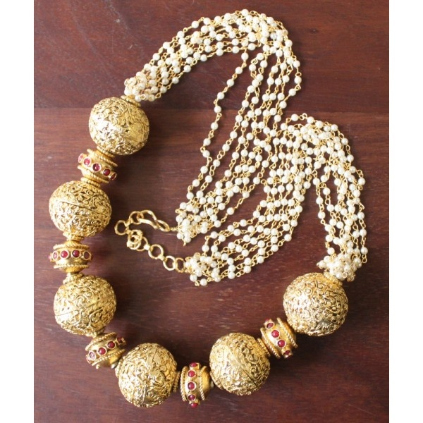 Faux pearl necklace with Tibetan beads