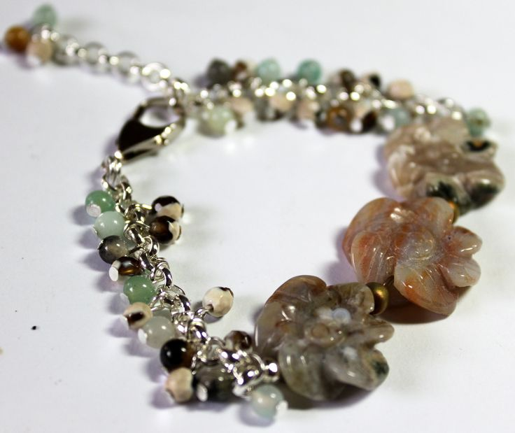 This charm bracelet is made up of Carved Oceam Jasper Flower Beads, Amazonite and Jasper round beads. Length – 18cm, with extension chain up to 22cm.  $42  www.preciouzpiecez.com.au