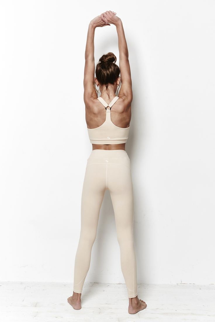 Nude double lined seamless sports bra with 'tri' strap and metal ring…