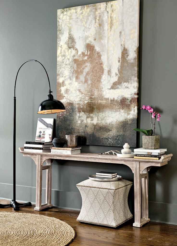 This gorgeous entryway is a study in balanced -- a metallic art print looks fantastic on top of a white-washed console table.