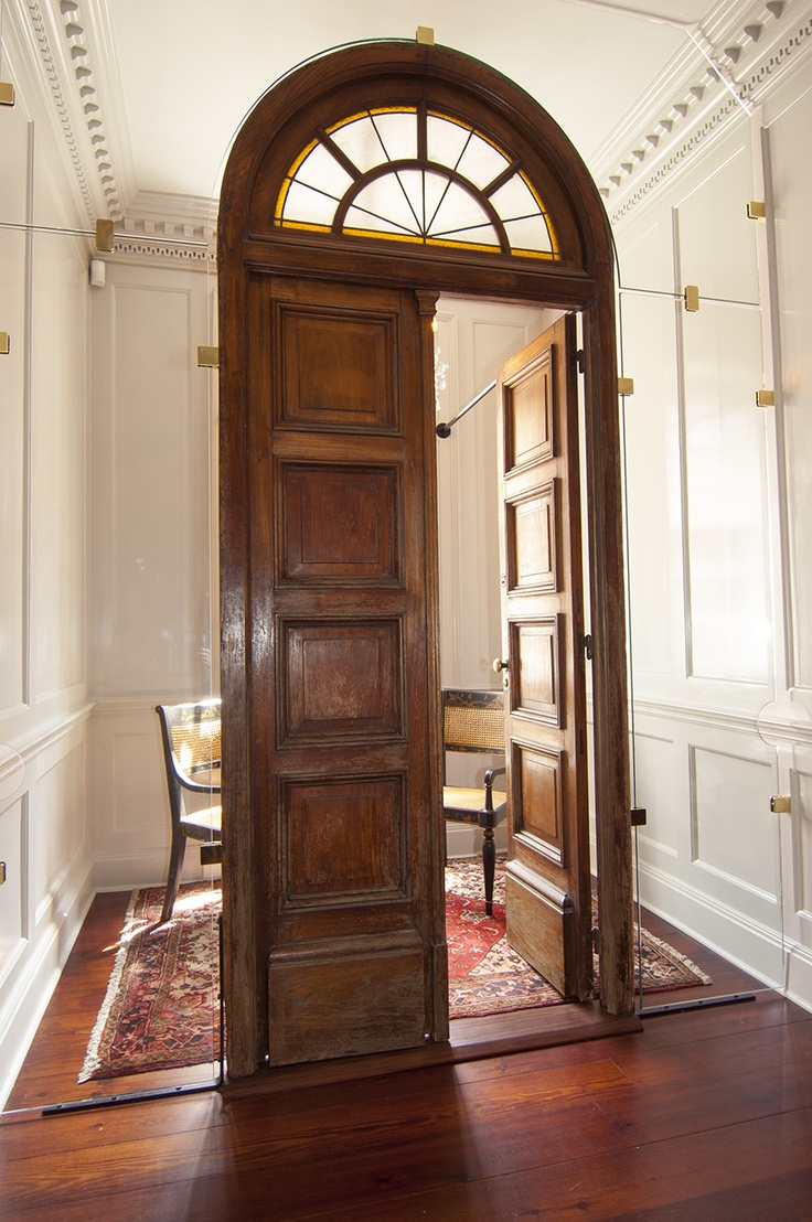 A beautifully restored door on the 2nd floor landing. There is glass that surrounds it and it serves as a private conversation space. & A beautifully restored door on the 2nd floor landing. There is ...