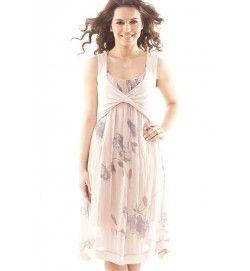 I 100% silke får du denna mycket feminina klänning med vackert blommönster. Ca 102 cm lång, med underklänning. Överdelens drapering är i viscose/elastan. Onesize XS-L. SEK 679:-
