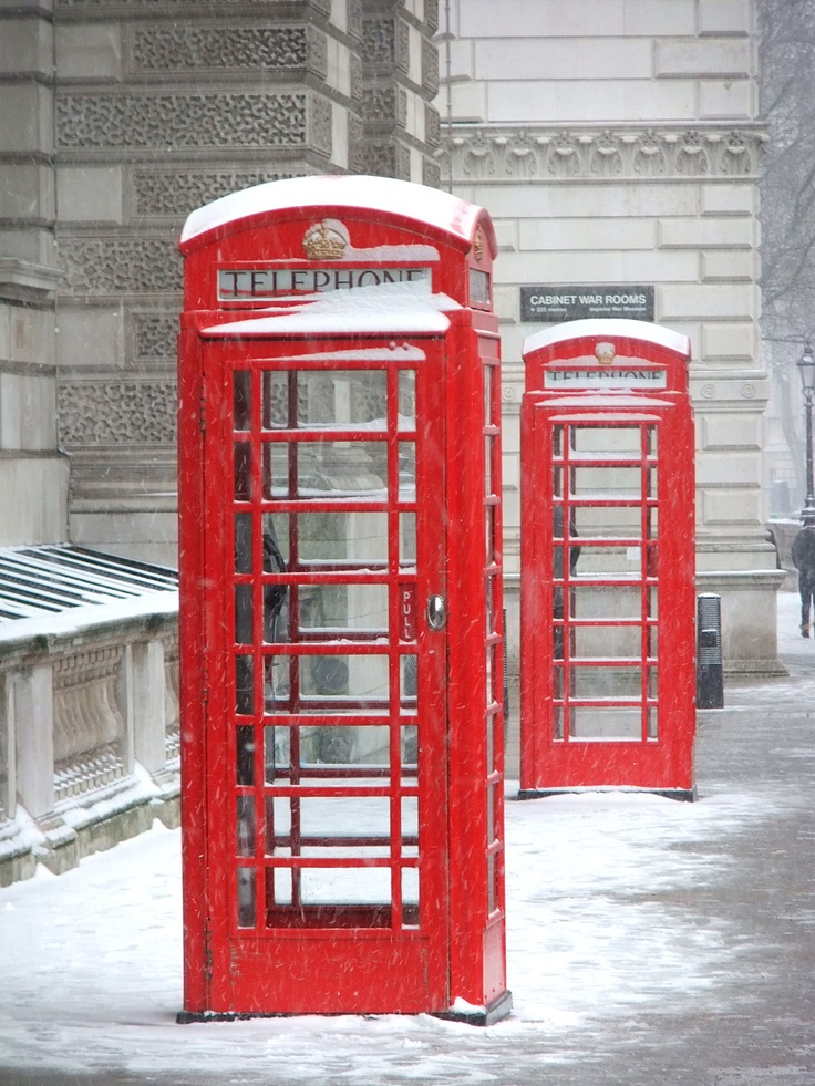 London calling ... under the snow    This photo was taken yesterday in the very central Whitehall, near the Parliament and the Big Ben    The red phone boxes are a trademark of the British culture. And when snowing ... how more iconic can you get?