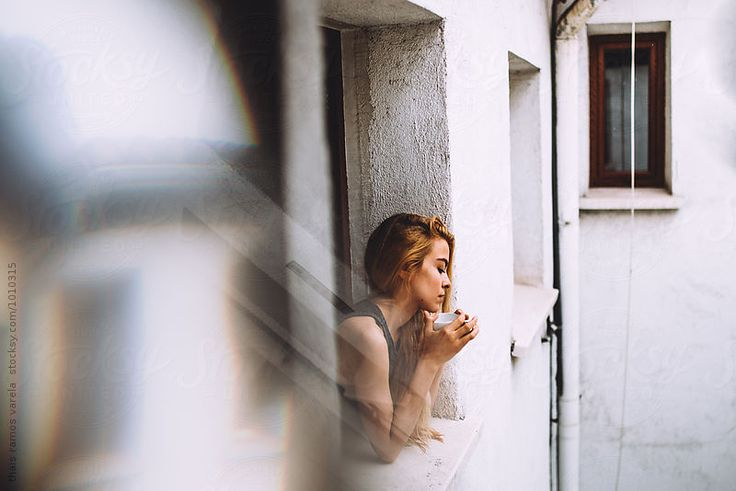 portrait of a beautiful young woman at the window