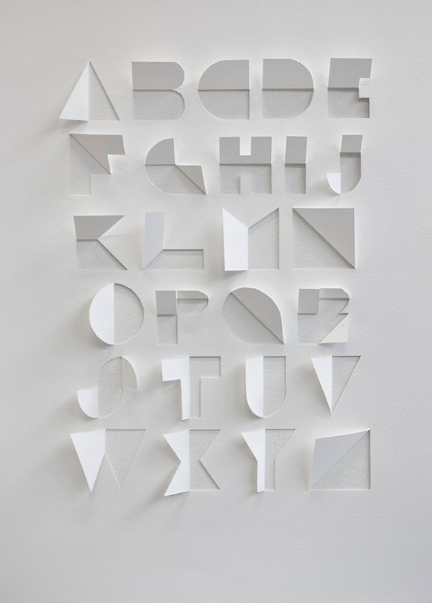 Found on the internet :Alphabet made out of a sheet of paper by cuts and folds by Gina Hollingsworth , a summer school student at Centr...