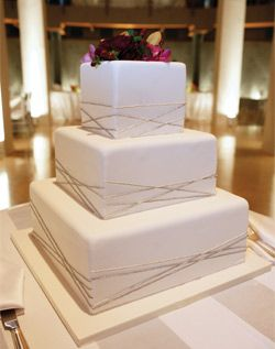 White Square Wedding Cake.  I love the look of this cake.  Imagine it with a elegant topper.