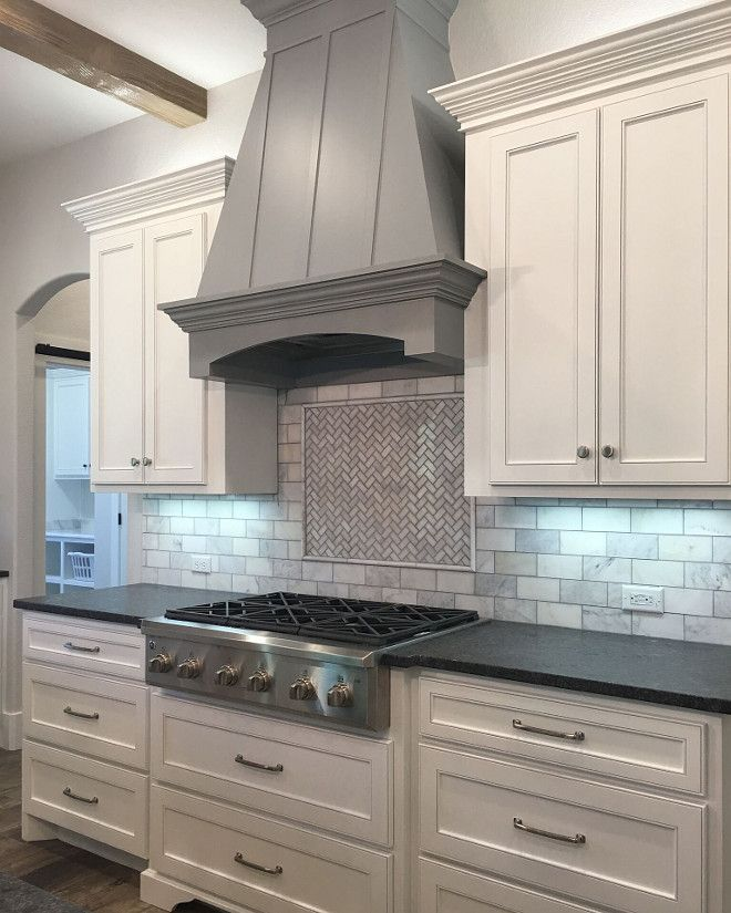 White cabinets paint color is Sherwin Williams Extra White. Grey hood paint color is Behr Gateway Grey.