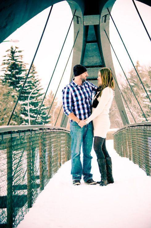 Regina, Saskatchewan Engagement Photography by Pure Photography & Design. Beautiful couple posing on a bridge in the winter time. www.purephotographyanddesign.com #reginaengagementphotography, #reginaengagementphotographer, #engagementphotographyideas, #reginaweddingphotographer, #reginaweddingphotography, #engagementphotography, #engagementpictures