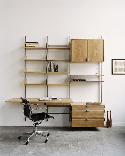 the as4 modular furniture system shown in white oak, used as a home office, desk surface, cabinets, decks, and drawers all made from solid hardwoods