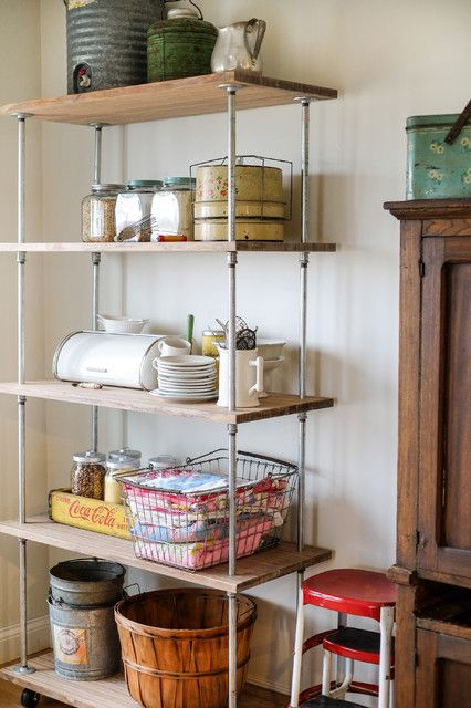 Inexpensive use of plumbing materials for industrial shelving. LOVE!