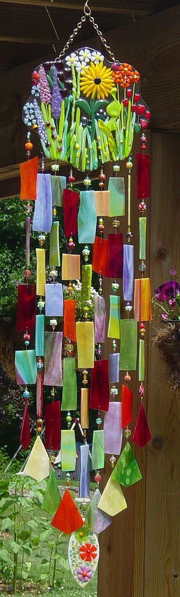 Secret Garden - wind chime  I believe this the main component to this beauty is random cuts of stain glass. Easy enough to cut glass, just get a tutorial or advice from expert at store you buy it from (online or local HELP is there) .. and be careful when... you deal with any sharp edges, always wear glass proof gloves