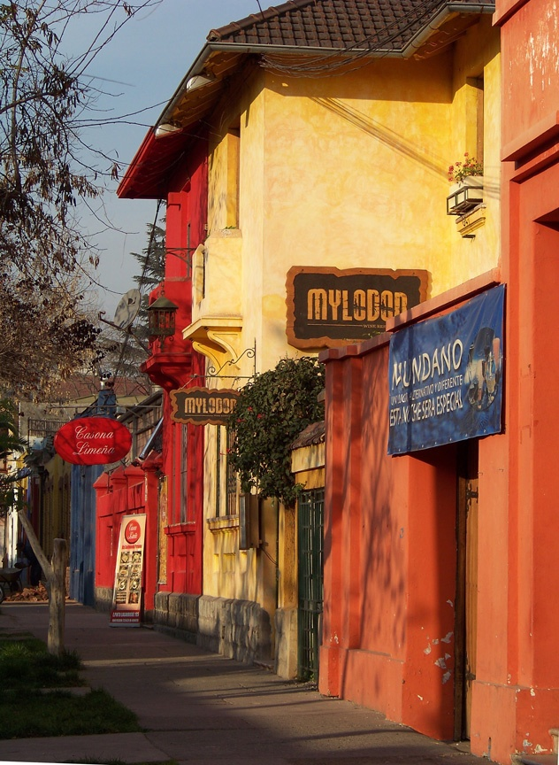 via www.mountainadventures.com Santiago, Chile. Colorful, bohemian, Barrio Bella Vista. Great place to wander, eat, relax.