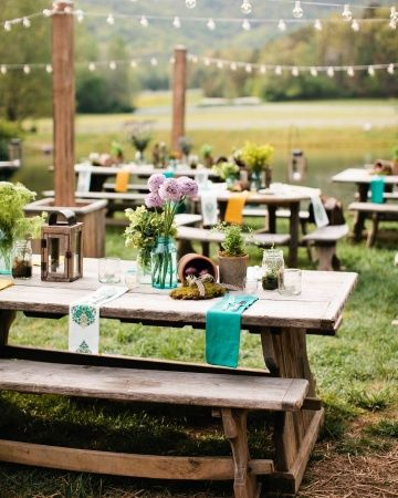 Cypress picnic tables set with colorful napkins