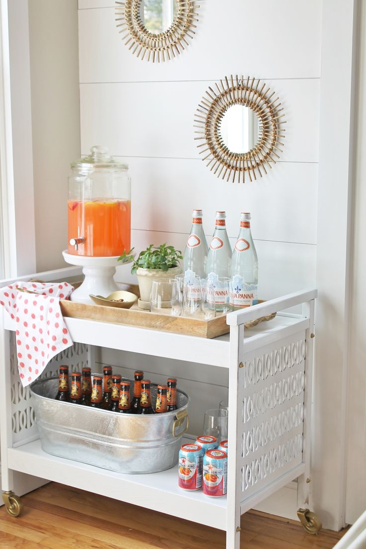 I like this idea for entertaining! Bar Cart Mini Makeover With Rattan Mirrors and Planked Wall