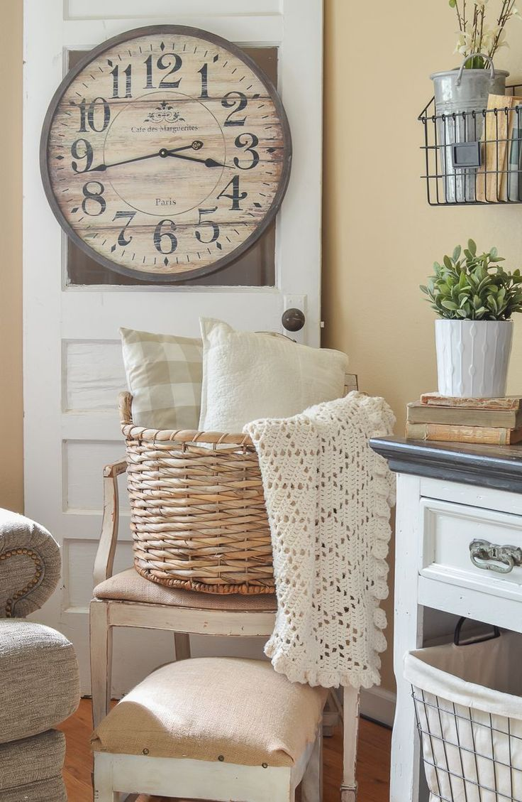 Farmhouse style decor in living room. Old door with basket and cozy blankets.