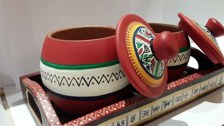 Two Terracotta Hand painted Warli Jars.   With Ethnic Wooden Tray.   Gives a classy and peppy feel to your table décor.