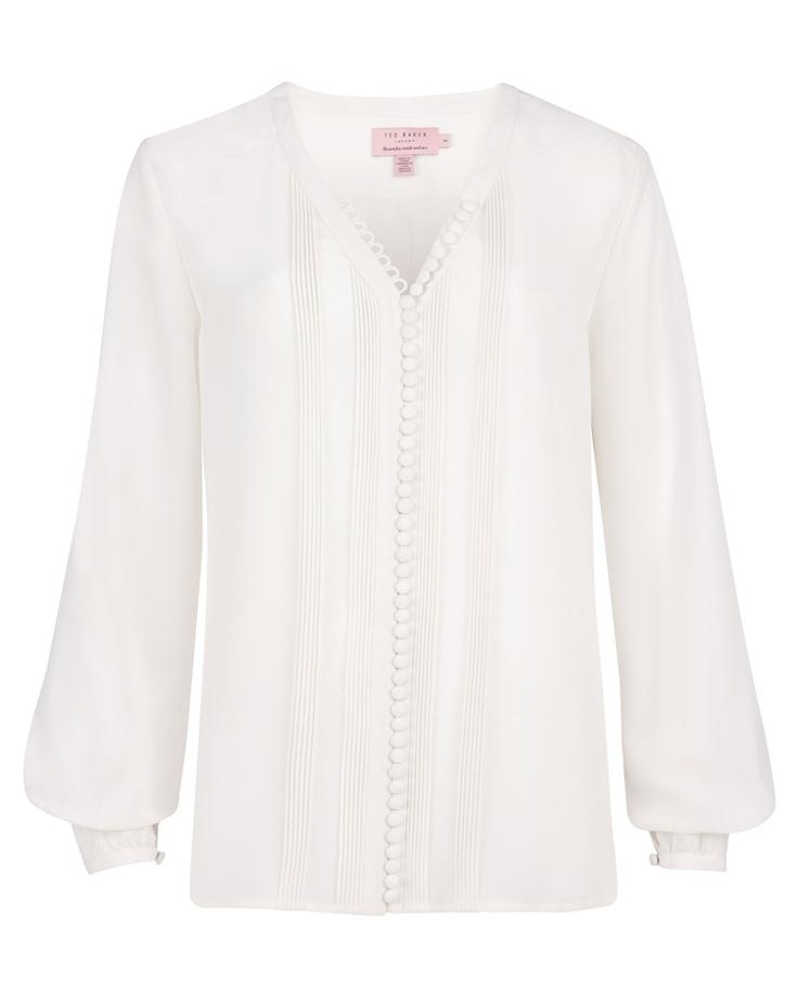 Camisa blanca de manga larga