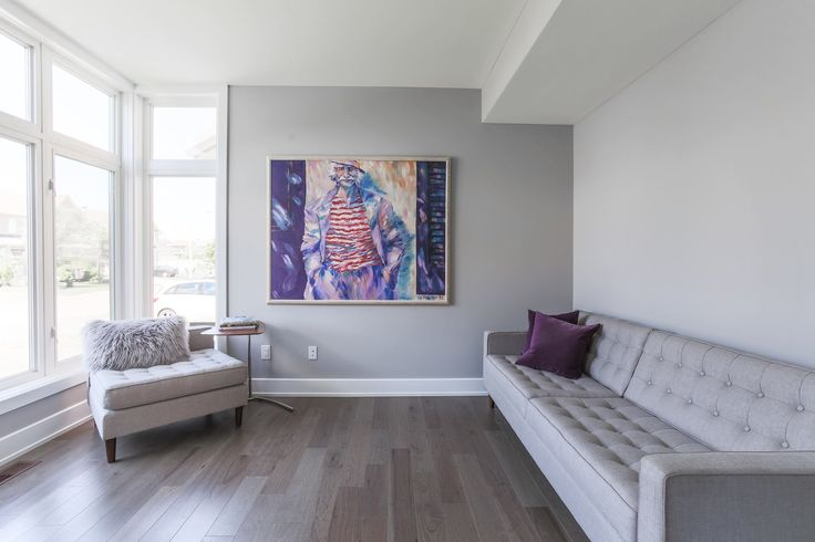 Beautiful living room featuring Lauzon's Natural Hickory hardwood flooring from the Émira Series. This flooring features the exclusive air-purifying technology called Pure Genius technology. Project realized by Campanale Homes