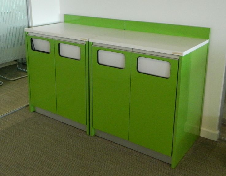Four door green laminate recycling storage with white worktop and flap apertures.