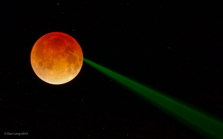 """Total lunar eclipse. The green light beam is a laser being used to measure the Earth-Moon distance. The laser's target is a retroreflector left on the Moon by Apollo 15 astronauts. Timing the return of the laser pulse allows a highly accurate determination of the distance traveled. Performance is improved during the eclipse because direct sunlight is blocked. (Credit & copyright: Dan Long) Mona Evans, """"Blood Moons and Lunar Tetrads"""" http://www.bellaonline.com/articles/art301030.asp"""