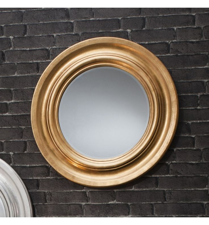 Combining the popular nautical theme with a contemporary design, the Trina round gold mirror is a stunning example of how trends can intertwine. The round mirror is encircled by a scooped frame topped off with a luxurious finish of gold leaf.  Size:- 84 cm