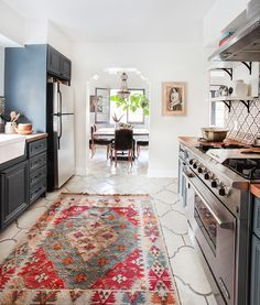 Love the not-white cabinets, the butcher block counters, the floor tiles, and that rug!