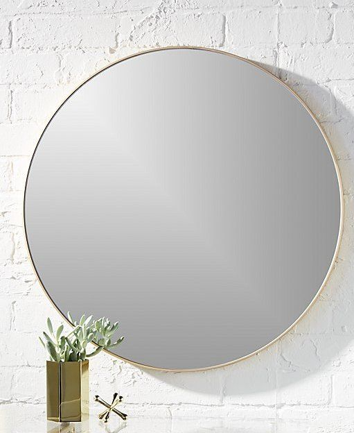 """simple reflections. Mirror image without bounds framed thin, trim and exact in pure extruded aluminum with a brushed brass finish. Handmade frame resists corrosion so it's perfect in the bath. infinity 24"""" round brass wall mirror is a CB2 exclusive."""