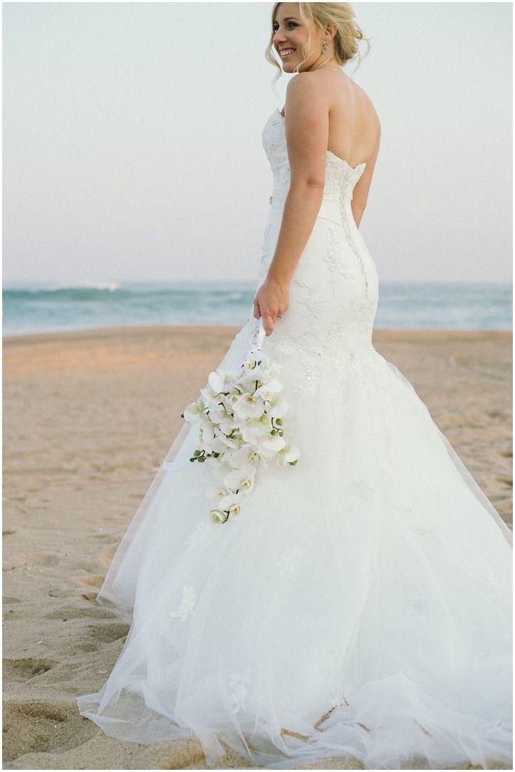 Brightgirl Photography. Bride on the beach #bride #sunset #beach #orchidbouquet #mermaiddress #orchidbouquet #PalmDunes #KZNNorthCoast