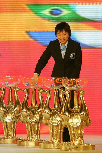 FIFA women's football ambassador Sun Wen from China draws a team from the pot during the final draw for the FIFA Women's World Cup China 2007 …