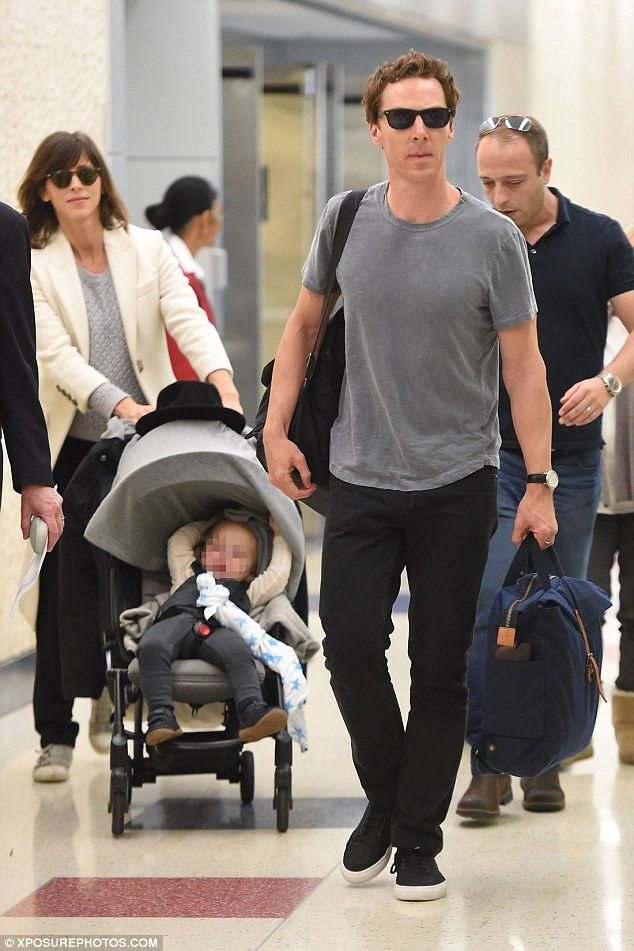 Relaxed: The Sherlock Holmes star, 40, cut a casual figure in a grey T shirt and black jeans as he made his way through the terminal with his pregnant wife, Sophie Hunter