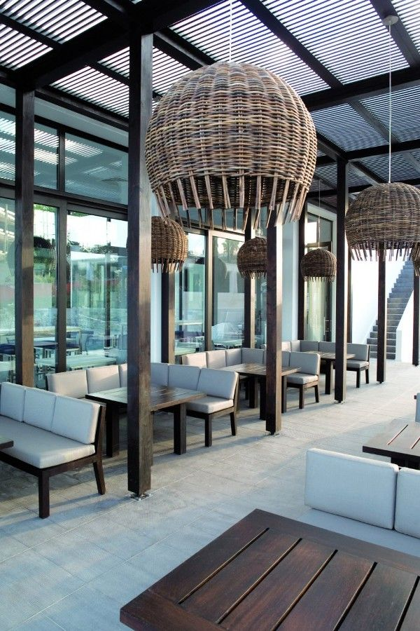 the Almyra Hotel in Cyprus - outdoor space. We love those large pendant lights!