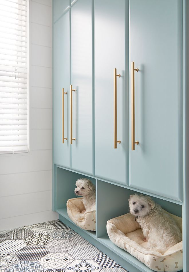 Mudroom with built in dog beds. Good designers take everyone in consideration when designing a space, including pets! These adorable dogs always loved sleeping in the laundry room, so designing a built-in bed for them was just natural.  Flooring is Ceragres St-Barth 8 x 8 hex with laticrete dark grey grout.
