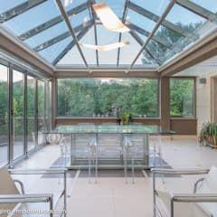 DENTRO IL PAESAGGIO: Giardino d'inverno in stile in stile Moderno di CATERINA CAMEROTA ARCHITETTO