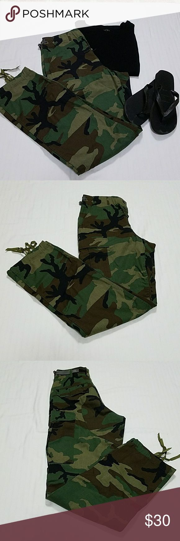 """Military Issue Camouflage Pants Excellent condition camouflage pants with button fly, cargo pockets and optional use drawstring on legs. Per tag - size XS Long, waist up to 27"""", inseam 32-1/2"""" to 35-1/2"""".  Super cute with flip flops, Chucks or even a moto boot.  Feel free to ask questions.  Reasonable offers welcome. Pants"""