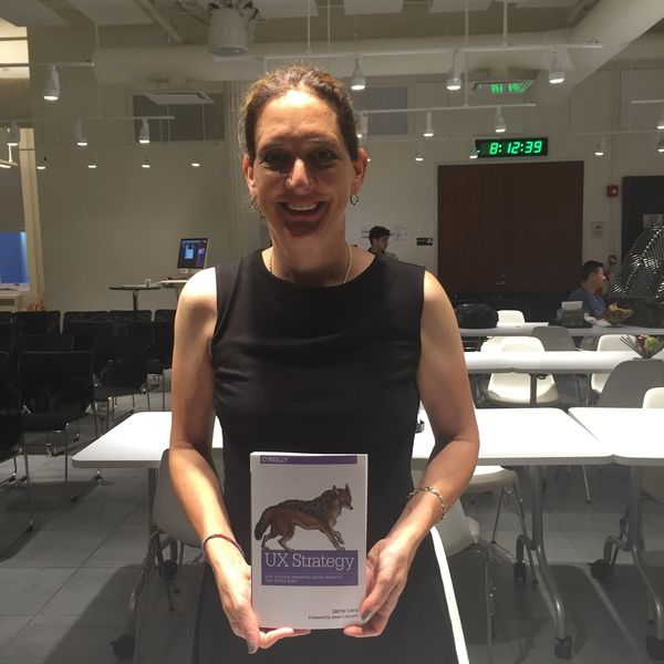 """Black dress from Uniqlo ($31), """"UX Strategy"""" book from O'Reilly Media ($35), Big smile (priceless)"""