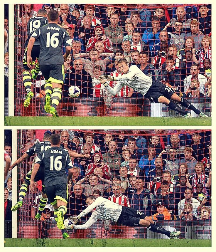 Simon Mignolet saves a penalty at Anfield.