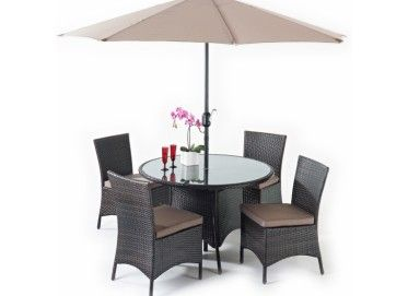 Our Luxe Round Dining 4 set consists of a round dining table with a glass top, 4 chairs which come with cushions, a parasol and parasol base.